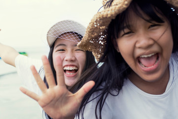toothy smiling face of two asian teenager happiness emotion