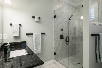 Simple luxury bathroom with granite and marble in residential home or hotel.