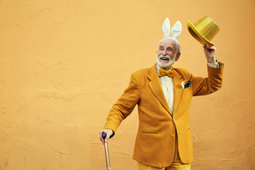 Cheerful senior man in funny clothes stock photo