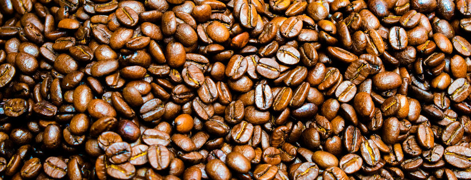 Close up roasted coffee beans background for banner