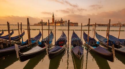 Foto op Aluminium Gondolas Gondolas moored in St. Mark's Square, San Giorgio Maggiore church in the background, Venice, Italy