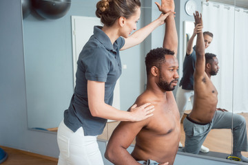 Young man receiving physical therapy after sport injury