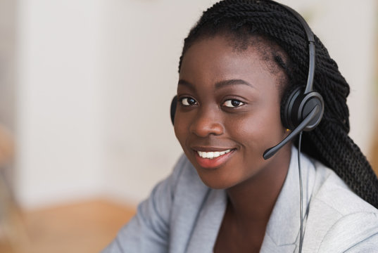 Portrait of beautiful black female customer service manager in headset