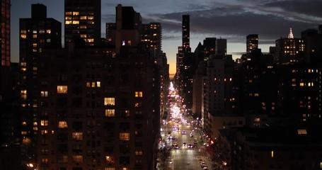 Fototapete - New York City evening sunset buildings skyline moving dolly
