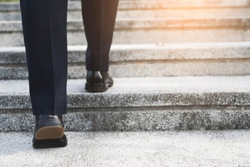 Image of a businessman walking up the stairs
