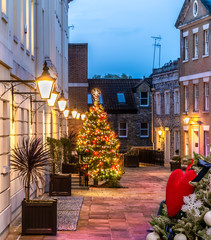 Beautiful Christmas scene outdoors in a town square of Richmond village with decorated tree and lights as the symbol of winter holiday in London