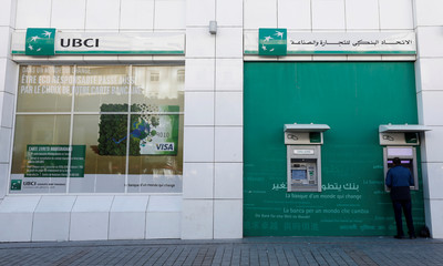 A man uses an ATM cash machine of the UBCI bank in downtown Tunis
