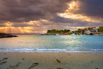 Golden sunbeams through stormy clouds in Tersanas village, Chania, Crete, Greece.