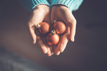 Fototapete - Close up woman hands holding red Christmas ball, Christmas decorative ornament concept
