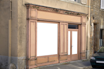 A traditional shop front in rural France.  Copy space to infill blank windows,