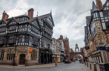 Photo Stands Old building 9 August 2019: Chester, Cheshire, England, UK - Half timbered houses in Bridge Street in cloudy day