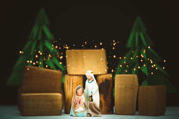 Christmas nativity scene of born child baby Jesus Christ in the manger with Joseph and...