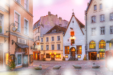 Decorated and illuminated Christmas street in Old Town of Tallinn at sunrise, Estonia