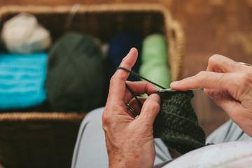 Senior Woman Knits and Sews