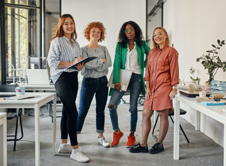 Portrait of confident female business team in office