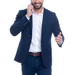 Confident professional businessman explain while calling isolated on white