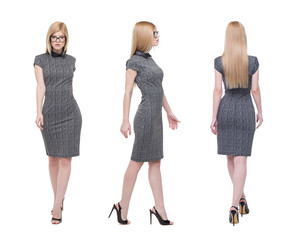 Blonde businesswoman walking front side back view isolated on white