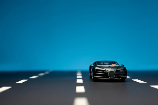 Front view of a Black colored Bugatti Veyron toy car.