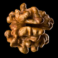 Macro photo of kernel walnut isolated on a black background with clipping path