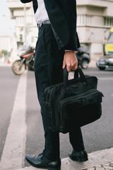 Man carrying black laptop bag