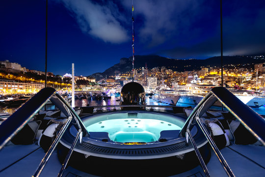 Beautiful shot of a night view full of lights and adventure from a private yacht
