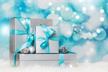 Silver christmas gifts on blue background