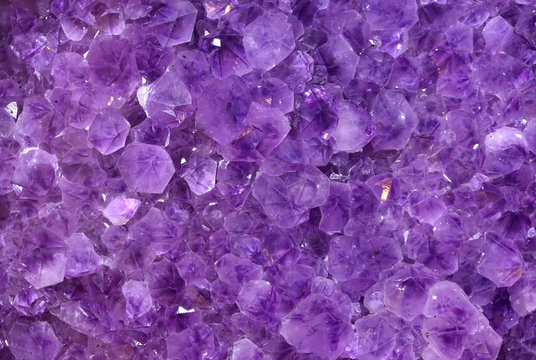 Gemstones amethyst bright purple, texture of stone. Beautiful background of amethyst stones