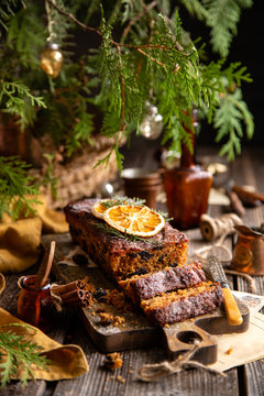 homemade traditional christmas fruit cake cut on slices with fruits, nuts, dried citrus