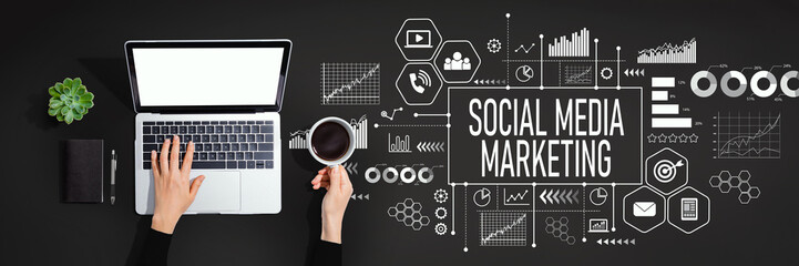 Social media marketing concept with person using a laptop computer