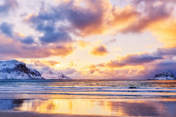 Beautiful northern nature. Amazing dramatic sunset landscape of Norwegian Lofoten Islands over Polar circle. Winter vacations for travelers on North of Europe background.