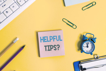 Text sign showing Helpful Tips Question. Business photo showcasing secret information or advice given to be helpful knowledge Flat lay above copy space on the white crumpled paper