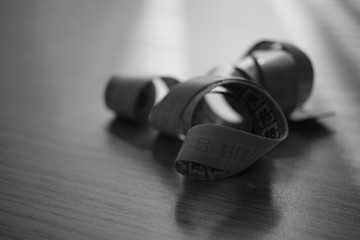 Measuring tape on the table. Black and white photo.