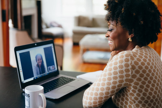 Businesswoman smiling and talking on video call