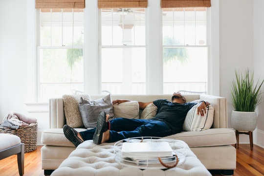 Man sleeping on couch at home