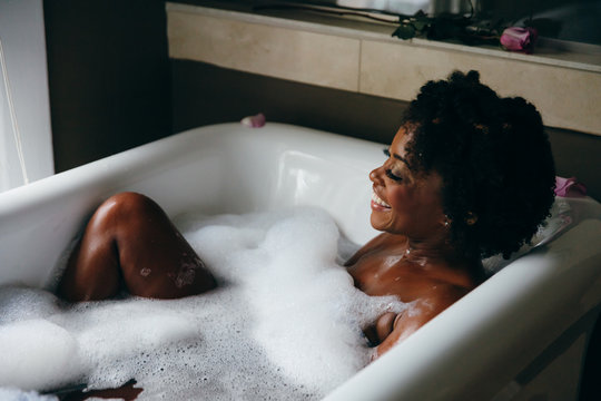 Woman relaxes in warm bubble bath