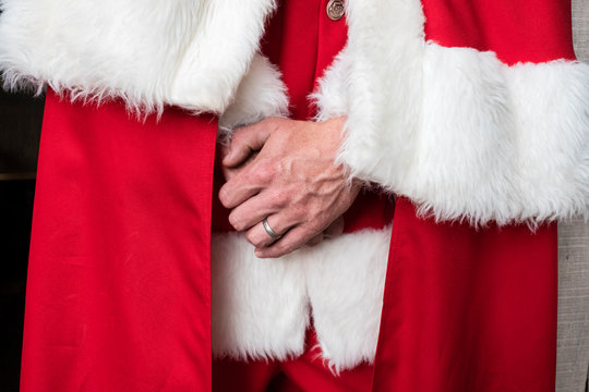 Close up of man wearing Santa Claus costume.