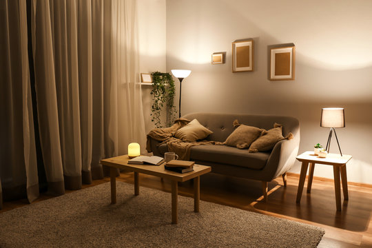Stylish interior of living room at night