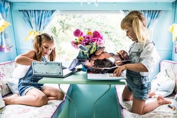 Girls playing at table in caravan