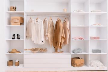Wardrobe with stylish female clothes