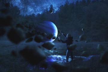 Aluminium Prints Night blue Man collecting rocks around a planet