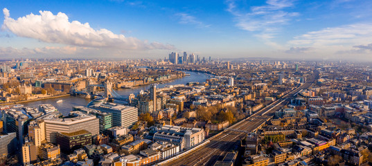 Fotomurales - Panoramic aerial view of London, UK. Beautiful skyscrapers, river Thames and railway going through the city.