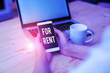 Handwriting text writing For Rent. Conceptual photo when you make property available for purchasing temporarily woman laptop computer smartphone mug office supplies technological devices
