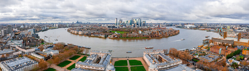 Wall Mural - Aerial panoramic view of the National Maritime Museum in Greenwich, England is the leading maritime museum of the United Kingdom and is the largest museum in the world. Canary Wharf view.