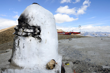 A mountaintop is outfitted with a stone structure in which to burn incense along with prayer flags in the Brahmaputra Valley of the Tibetan Plateau.