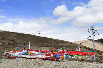 rayer flags are draped along on a Tibetan mountainside in Gompa Pass in Brahmaputra Valley near a military zone in Tibetan Plateau in Brahmaputra Valley of the Tibet Autonomous Region of China.