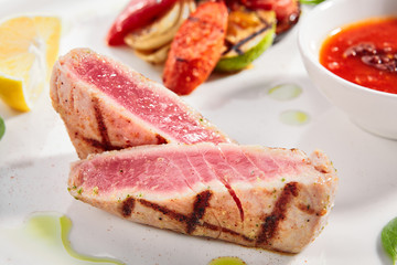 Tuna steak with grilled vegetables close up