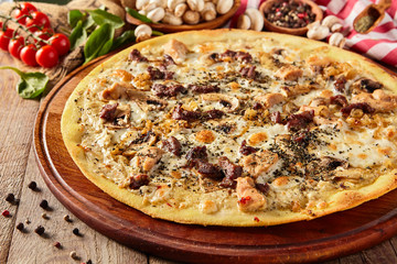 Mushroom pizza on wooden table
