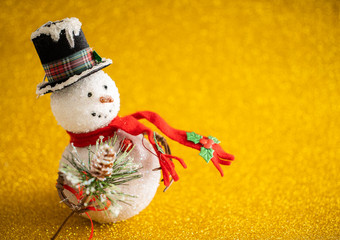 Christmas decoration snowman on gold glitter background