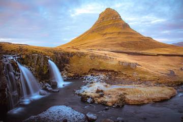Beautiful scenery Kirkjufell mountain and Kirkjufellfoss waterfall as foreground in Iceland.