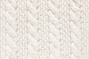 Cable knitting stitch pattern, soft woolen texture, handmade knitted cloth